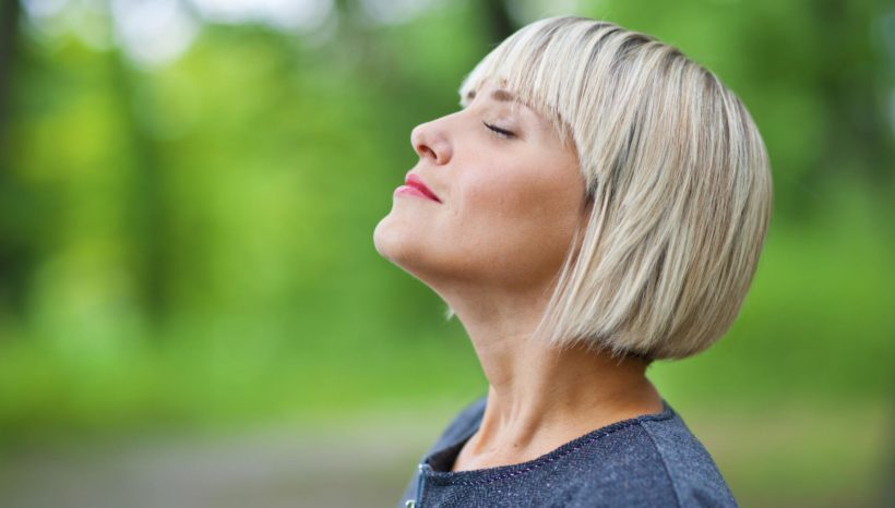 attractive woman breathing and relaxing